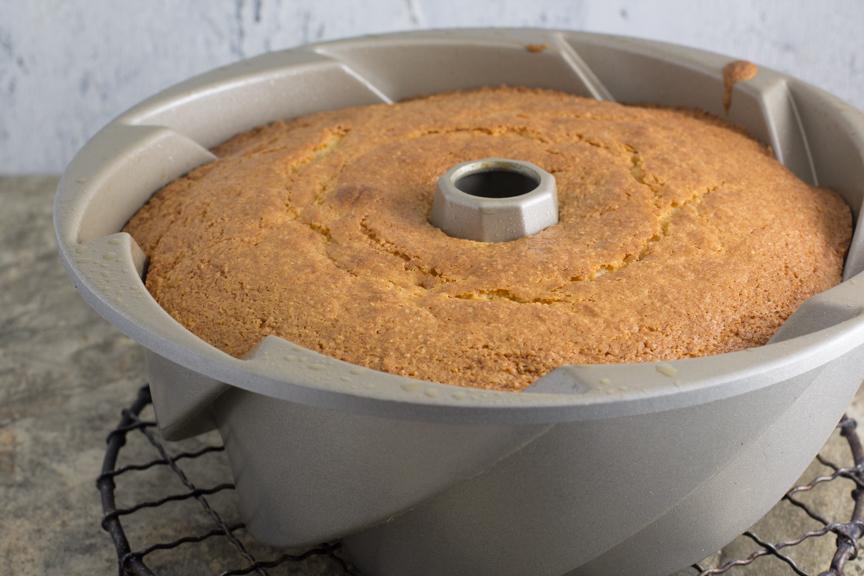 Vanilla Almond Tea Cake cooling in bundt pan