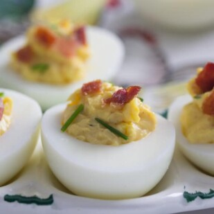 Monash University Certified Low FODMAP Bacon Deviled Eggs - no one passes these by! A lovely, simple and very tasty Low FODMAP appetizer. For more Low FODMAP recipes visit us.