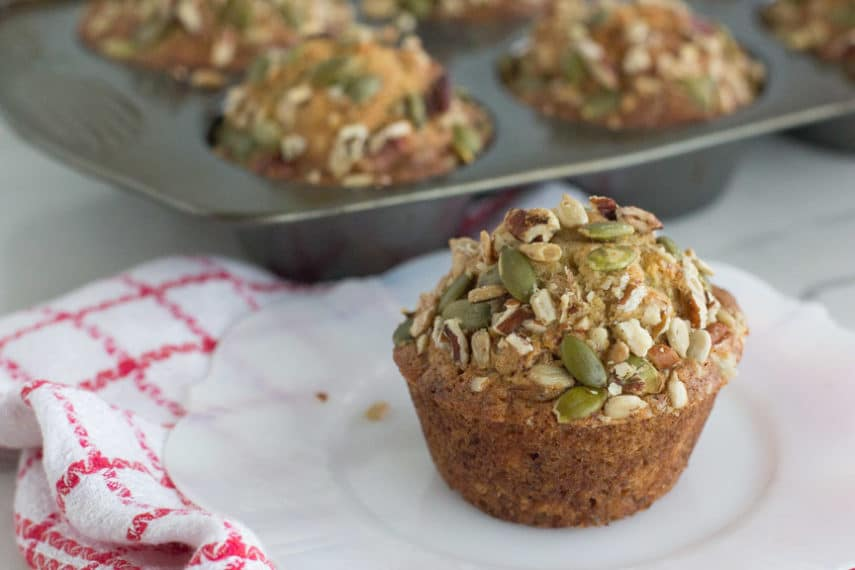 Low FODMAP Banana Muffin with seeds and nuts on a white plate