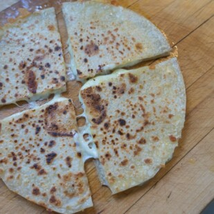 quesadillas on cutting board