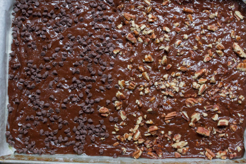Low FODMAP Decadent chocolate brownies - you can have BOTH plain and with nuts! All Low FODMAP! Look at this tray of uncooked brownies both styles- waiting for the oven.