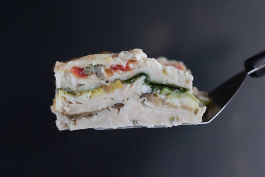 Low FODMAP Summer Vegetable White Lasagna cross section of layers of pasta, sauce and vegetables.