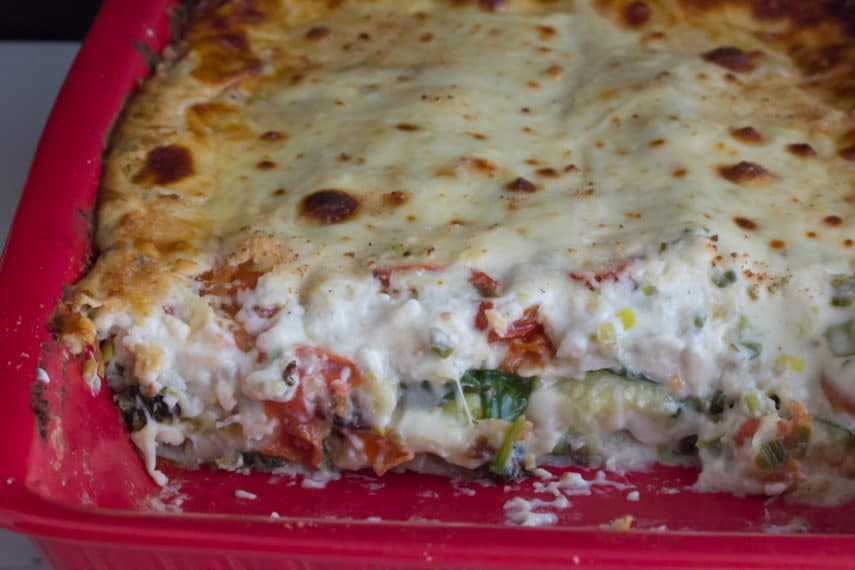 Low FODMAP Summer Vegetable White Lasagna in a red deep baking dish.