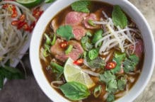 A bright bowl full of Low FODMAP Pho Bo (Vietnamese Beef Noodle Soup) - beautiful, comforting and delicious.