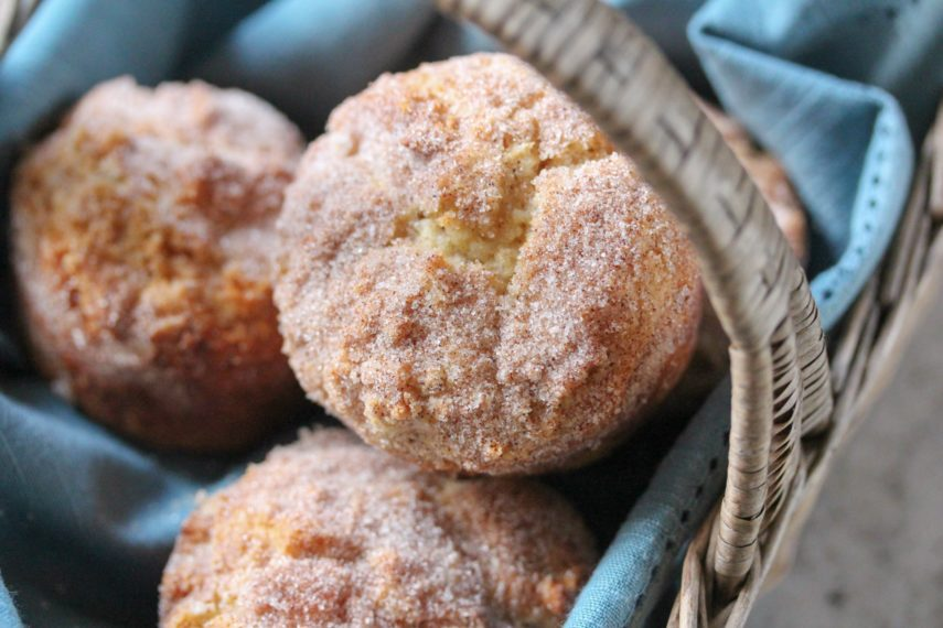 Low FODMAP Snickerdoodle Muffins in a cloth napkin-lined basket