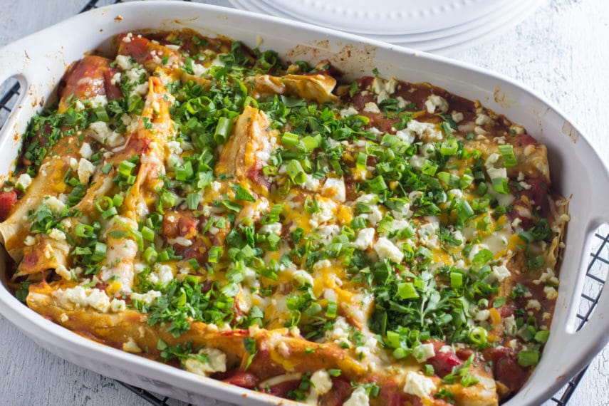 A baking dish with low FODMAP chicken enchiladas just our of the oven