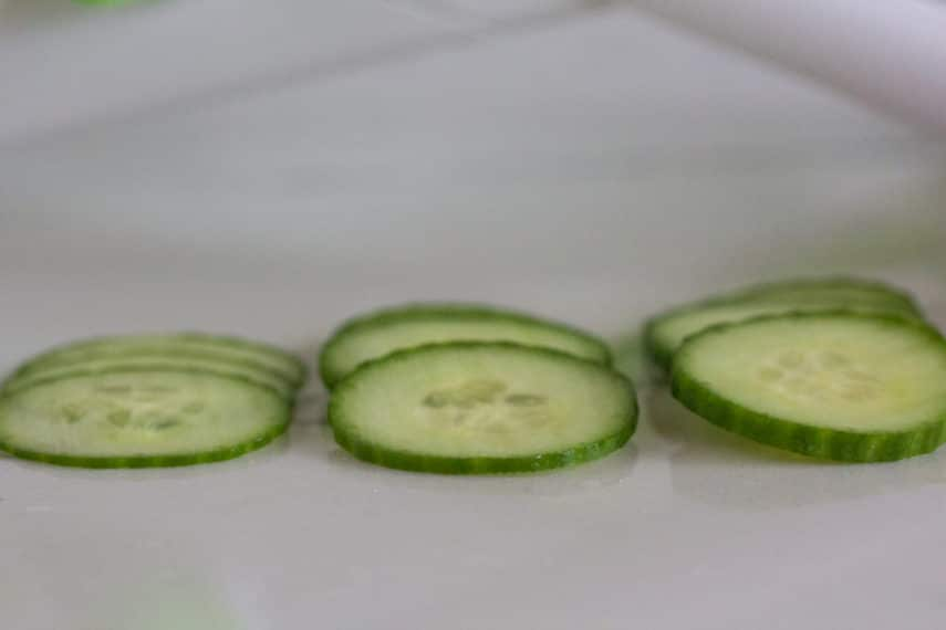 Mandoline sliced cucumbers in different thicknesses.