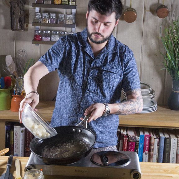 Freeman Wilson adding gnocchi to hot pan with browned butter