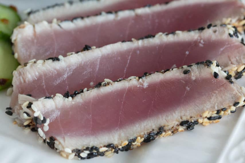 Low FODMAP Sesame Crusted Tuna sliced on a plate.