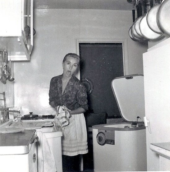 Mom making faces in the kitchen- 1960.