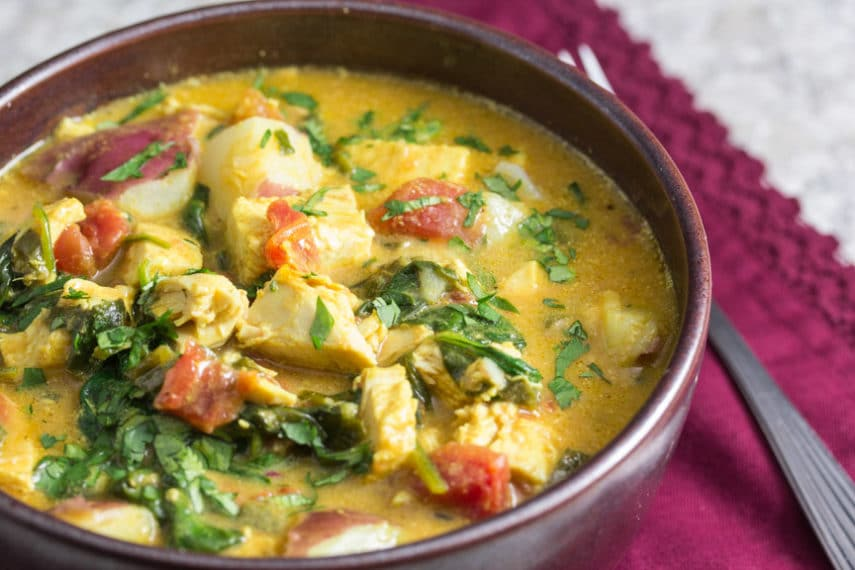 Turkey Coconut Curry with spinach in a rustic bowl