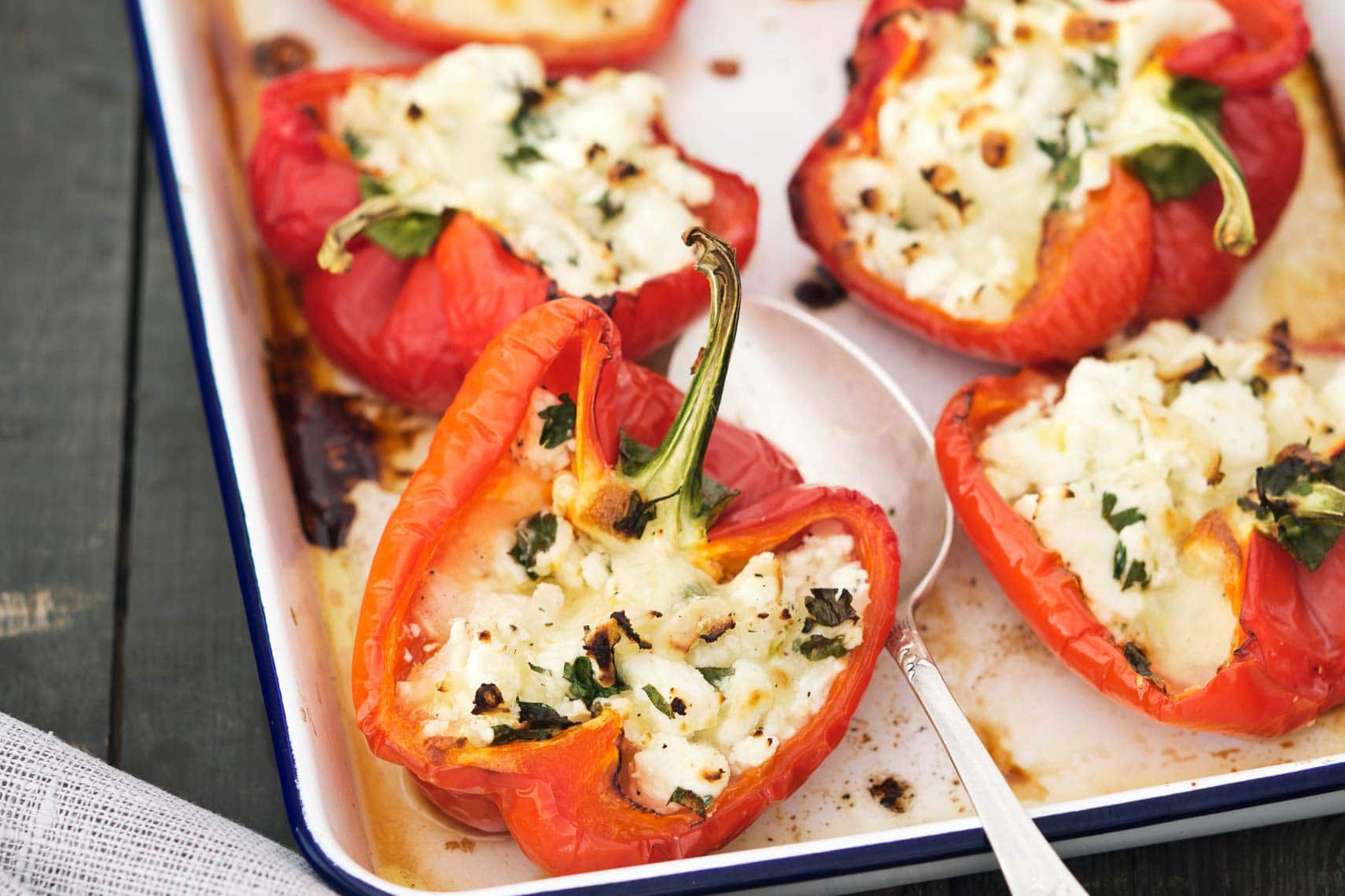 Stuffed Red Peppers with Quinoa, Zucchini, and Feta Cheese ...