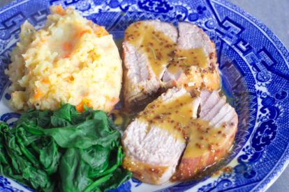 pork loin with maple mustard sauce plated