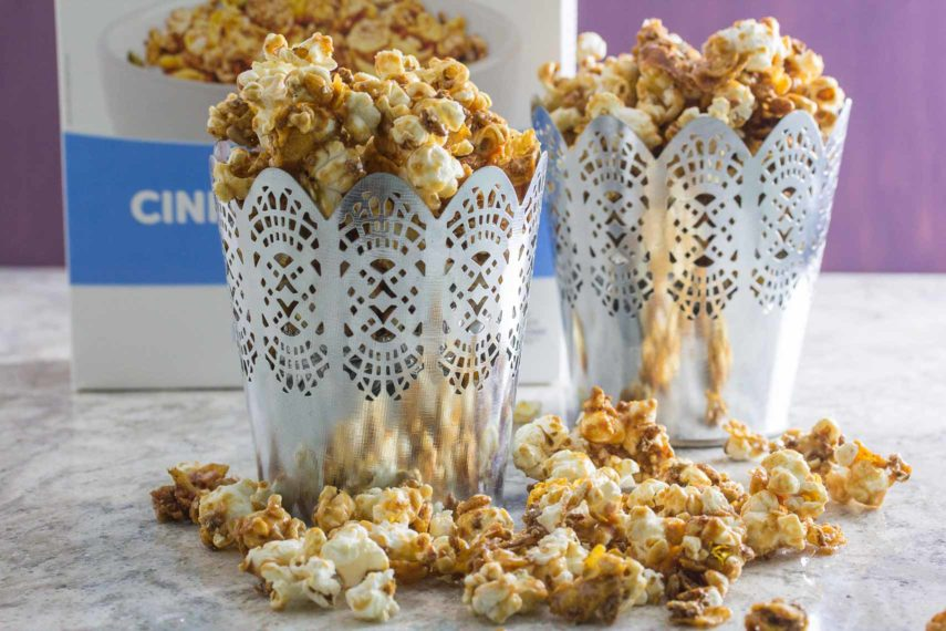 FODY Sweet n Salty caramel Popcorn spilling out of decorative silver containers