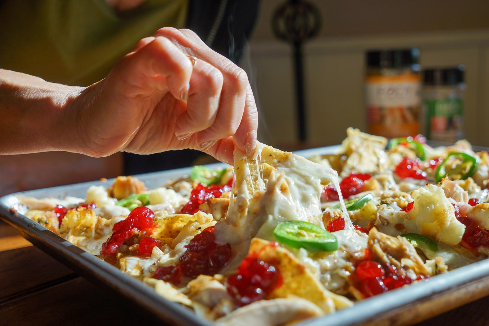 Digging in to Thanksgiving nachos fresh out of the oven withe melted cheese