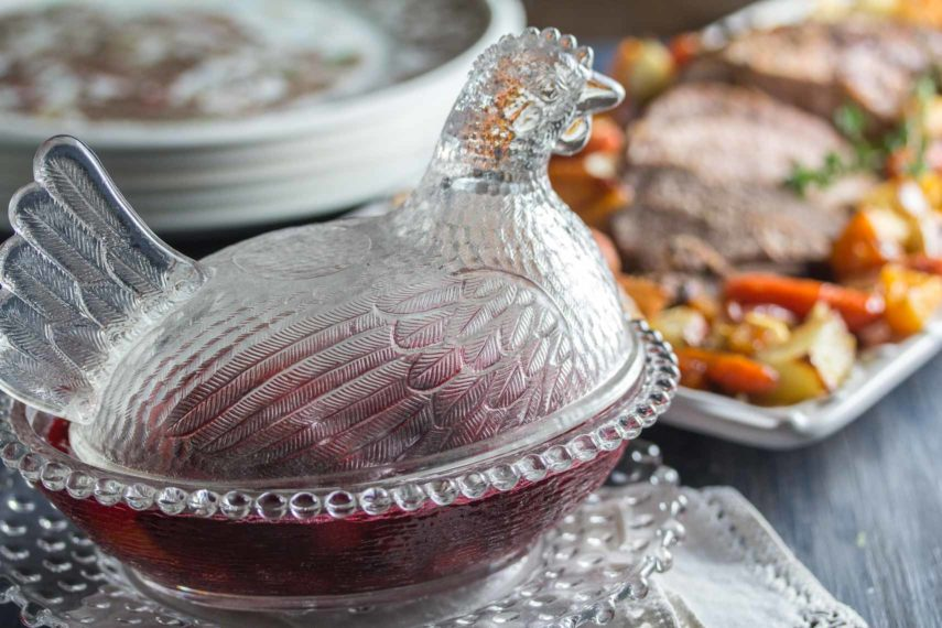Glass chicken dish filled with cranberry sauce