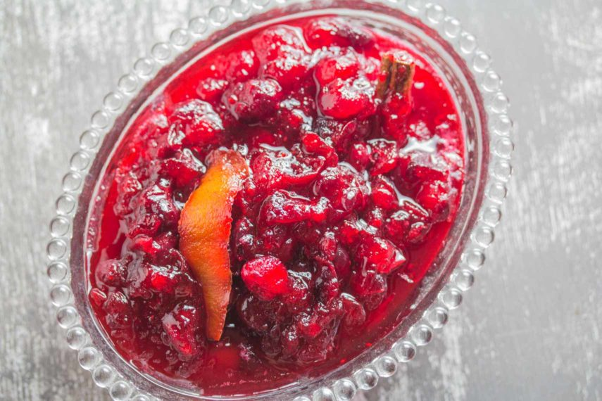 Citrus cranberry sauce in a glass dish viewed from above.