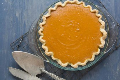 pumpkin pie sweetened with maple and enhanced with fresh lemon zest and fresh ginger on a cooling rack