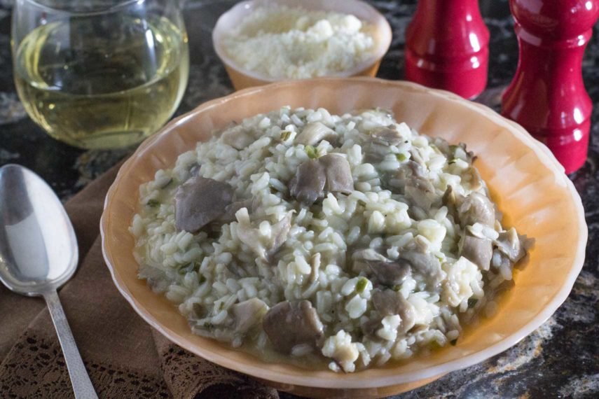 oyster mushroom risotto in an antique bowl with fluted edge