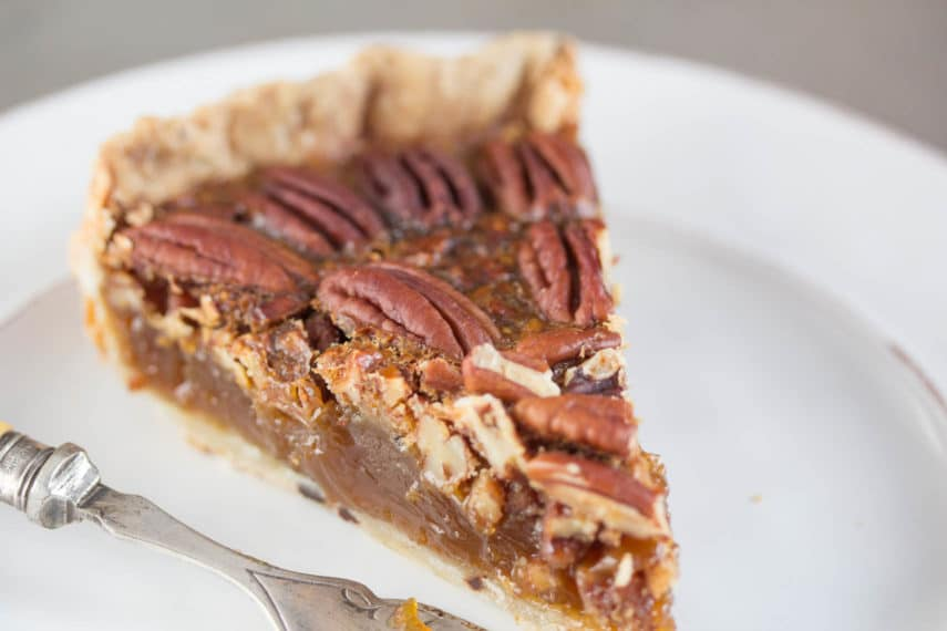 closeup image of browned butter salted caramel pecan pie
