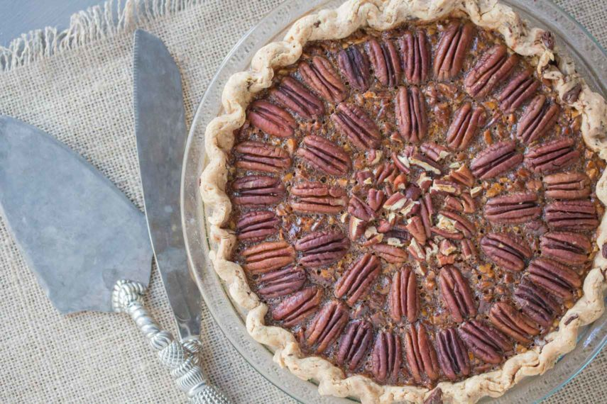 Overhead image of Browned Butter Salted Caramel Pecan Pie in a chocolate flecked pastry crust