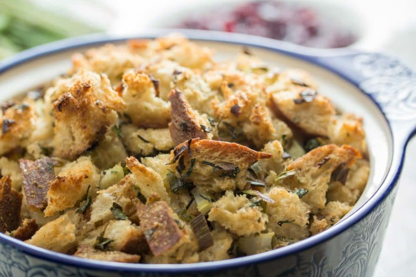 closeup of low FODMAP simple sourdough stuffing in a blue and white casserole dish
