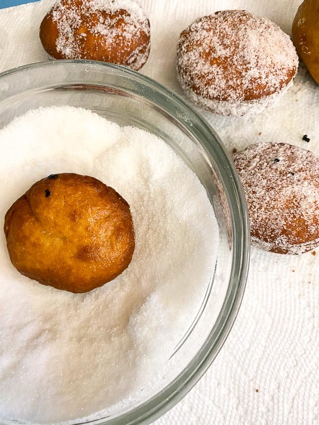 toss doughnuts in sugar right away