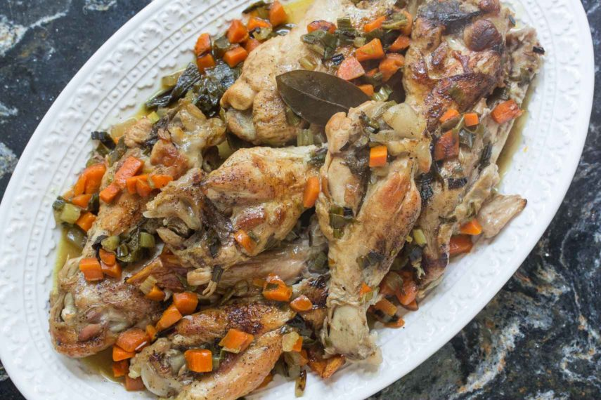 Braised turkey wings with white wine on a platter close up
