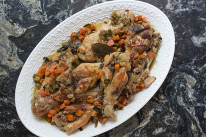 Braised turkey wings with white wine on a platter