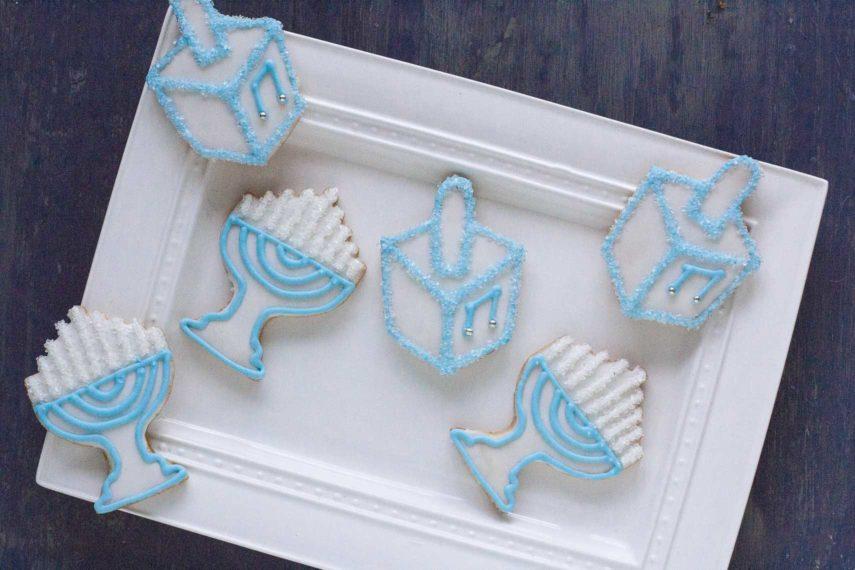 Hanukkah cookies on rectangular white plate
