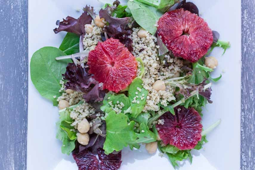 Grains & Greens: Baby Lettuces, Blood Oranges, Quinoa & Chickpeas on a white plate