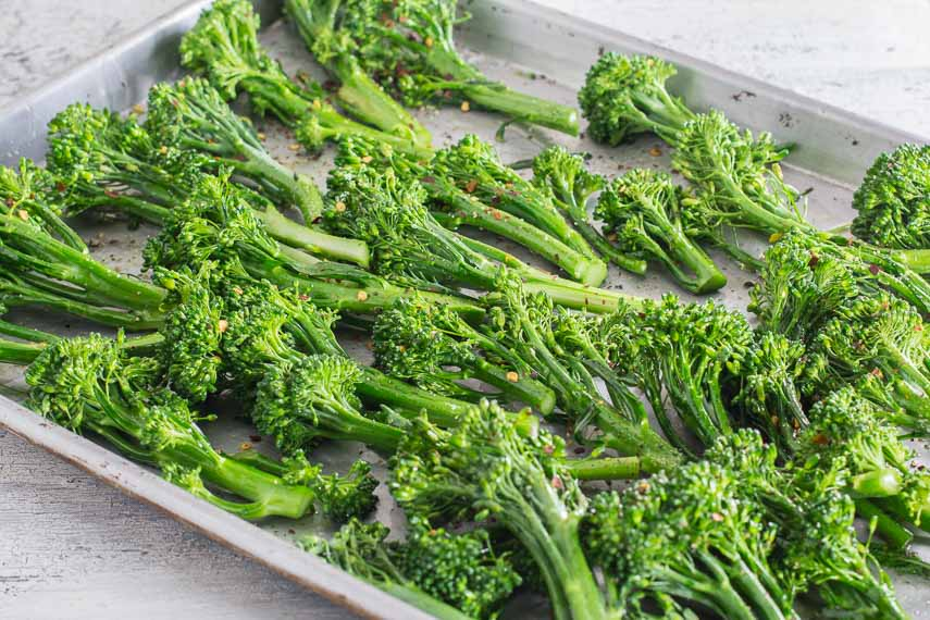 Low FODMAP Spicy Roasted Broccolini with Garlic & Lemon on sheet pan ready to roast
