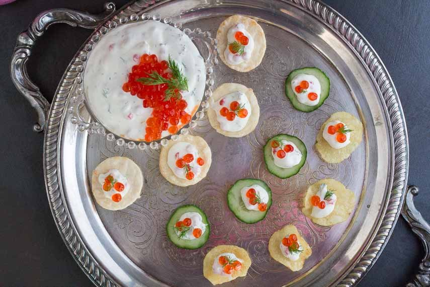 overhead shot of lactose-free low FODMAP caviar dip made with salmon roe on silver platter