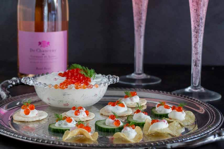Lactose-free low FODMAP caviar dip with champagne glasses