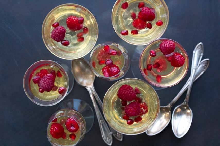 champagne gelee with raspberries & pomegranate overhead image