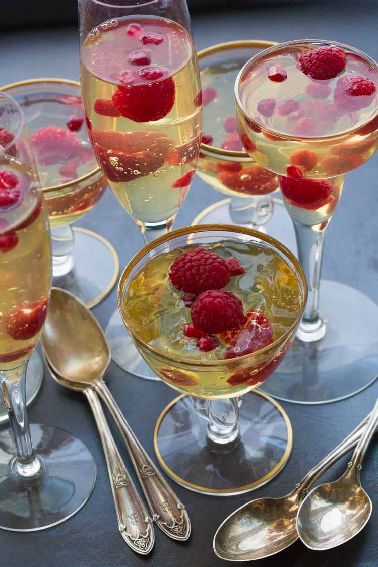 champagne gelee with raspberries & pomegranate vertical image