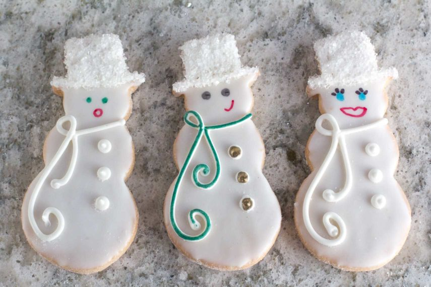 closeup overhead of decorated sugar cookies with edible pen details