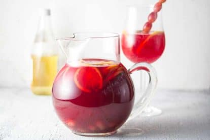 Sparkling Ginger Cranberry Punch in pitcher and glass