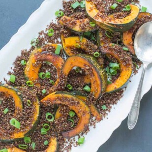 kabocha with crispy quinoa crumbs overhead shot on oval white platter