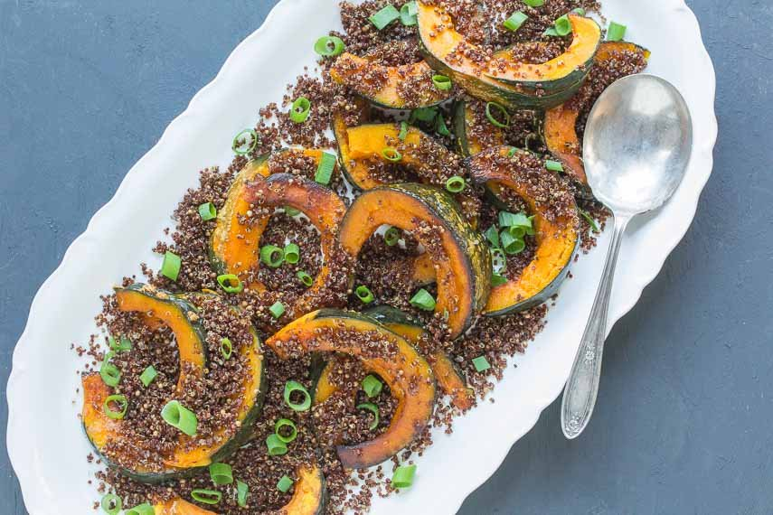 roasted kabocha with crispy quinoa crumbs overhead shot on oval white platter
