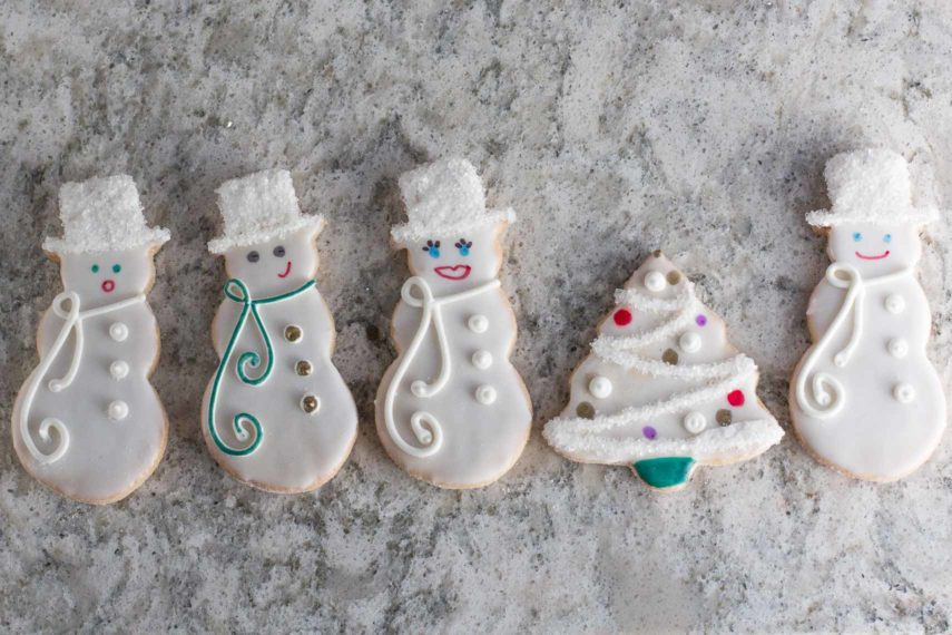 overhead of decorated sugar cookies with edible pen details
