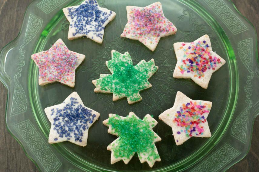 simple rolled sugar cookies with colored sugar decor on a green glass plate