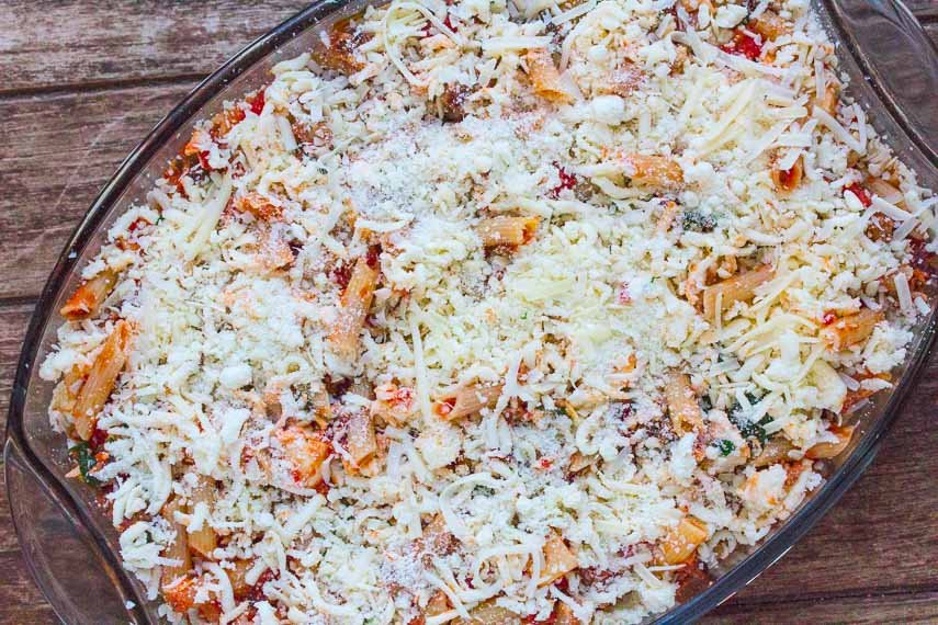 ziti unbaked with cheese sprinkled on top