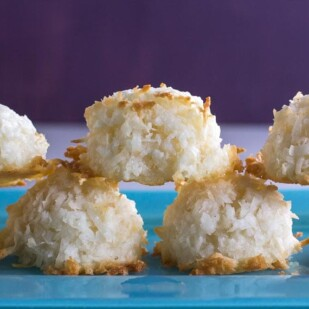 closeup of simple coconut macaroons on blue plate