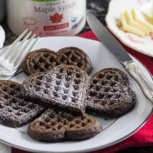 dark chocolate waffles with confectioners' sugar sprinkled on top