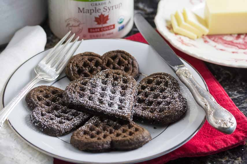 gluten free dark chocolate waffles with confectioners' sugar sprinkled on top