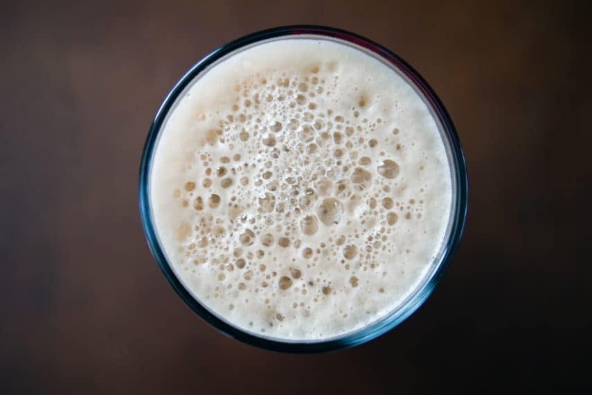 Lactose, Dairy and the Low FODMAP Diet-a birds eye view of a frothy glass of milk