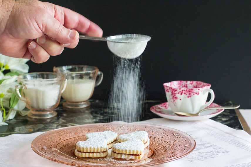 heart shaped sugar cookies, sifting sugar