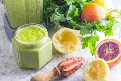 Citrus Herb Mojo ingredients with blender in background