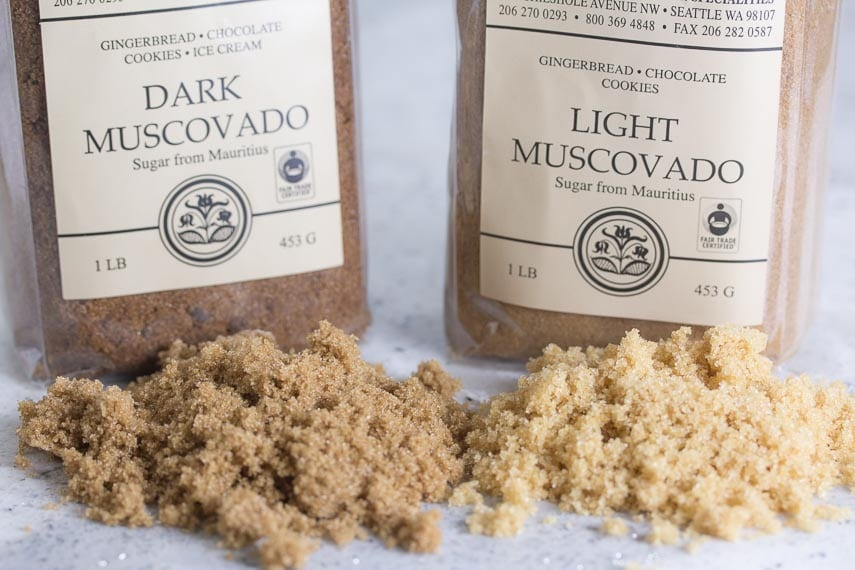 All About Sugar. Brown sugars and muscovado sugars on a white quartz countertop